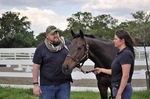 Sgt. Matt Ryba, USMC (ret.) with therapy horse, Crafty Star, a retired racehorse.