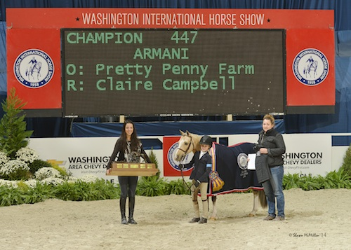 Armani and Claire Campbell in their grand champion presentation.